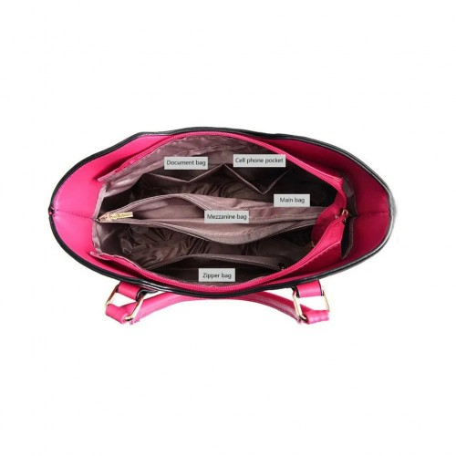 Soft surface handbag with embossed element